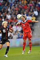 Canada  defender Carmelina Moscato (4) heads the ball.