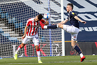 Tommy Smith of Stoke City heads the ball away as Millwall's Scott Malone challenges with his boot during Millwall vs Stoke City, Sky Bet EFL Championship Football at The Den on 12th September 2020
