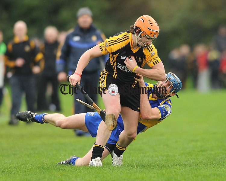 Cathal Doohan of Ballyea in action against David Barrett of Newmarket during their semi-final at Clarecastle. Photograph by John Kelly.