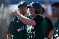 Dartmouth Big Green first baseman Michael Ketchmark (27) fist bumps teammates after scoring a run with Beau Sulser (10) looking on during a game against the Eastern Michigan Eagles on February 25, 2017 at North Charlotte Regional Park in Port Charlotte, Florida.  Dartmouth defeated Eastern Michigan 8-4.  (Mike Janes/Four Seam Images)