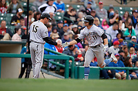 Charlotte Knights manager Mark Grudzielanek (15) congratulates Adam Engel (11) after hitting a home run during an International League game against the Rochester Red Wings on June 16, 2019 at Frontier Field in Rochester, New York.  Rochester defeated Charlotte 3-2 in the second game of a doubleheader.  (Mike Janes/Four Seam Images)