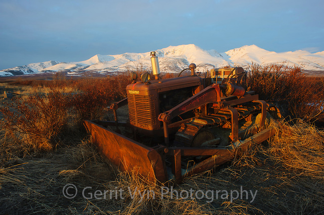 Old abandoned bulldozer and Kigluaik Mountains. Seward Peninsula, Alaska.