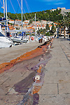 Beautiful harbor of Hvar Town with fishing net drying, Hvar Island, Croatia