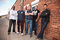 George Clarke (right) of Channel 4's 'Great Property Scandal' visits Pleasley in Mansfield to see how Screwfix have helped out with essential products for the Houses to Homes project.  Pictured from left are armed forces veterans Anthony Hazell, Declan Hill, Steven Van Der Bank, Steven Atkinson, and Kevin Barker with George.
