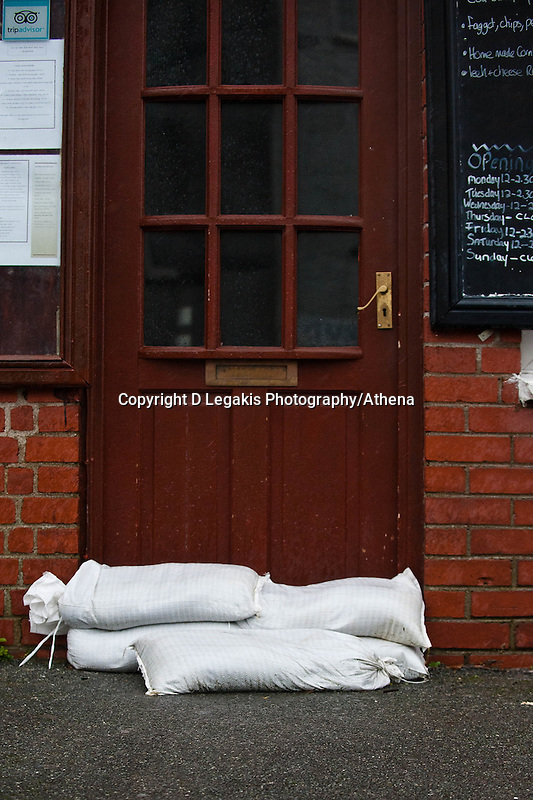 Friday 14 February 2014<br /> Pictured:Sandbags are stacked in front of a Shop in Laugarne, West Wales<br /> Re: Rain and gale force winds are again due to batter the UK