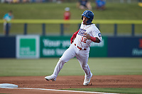 Jose Rodriguez (12) of the Kannapolis Cannon Ballers rounds third base during the game against the Charleston RiverDogs at Atrium Health Ballpark on June 29, 2021 in Kannapolis, North Carolina. (Brian Westerholt/Four Seam Images)