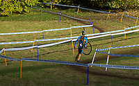 03 NOV 2012 - IPSWICH, GBR - Ben Boets (BEL) of Belgium carries his bike back to the pits during the Junior Men's European Cyclo-Cross Championships in Chantry Park, Ipswich, Suffolk, Great Britain (PHOTO (C) 2012 NIGEL FARROW)