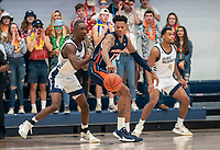 WASHINGTON, DC - NOVEMBER 16: Shawn Walker Jr. #1 of George Washington defends against Troy Baxter #13 of Morgan State during a game between Morgan State University and George Washington University at The Smith Center on November 16, 2019 in Washington, DC.