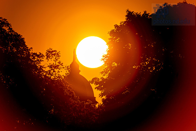 June 16, 2020; Sunrise behind the Dome (Photo by Matt Cashore/University of Notre Dame)