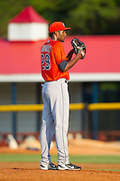 Greeneville Astros starting pitcher Reymin Guguan (29) looks to his catcher for the sign against the Burlington Royals at Burlington Athletic Park on June 30, 2014 in Burlington, North Carolina.  The Royals defeated the Astros 9-8. (Brian Westerholt/Four Seam Images)