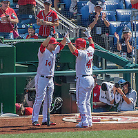 7 August 2016: Washington Nationals catcher Wilson Ramos is greeted by Chris Heisey after hitting a solo home run in the 7th inning against the San Francisco Giants at Nationals Park in Washington, DC. The Nationals shut out the Giants 1-0 to take the rubber match of their 3-game series. Mandatory Credit: Ed Wolfstein Photo *** RAW (NEF) Image File Available ***