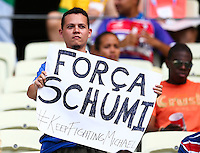 A supporter holds a sign saying 'Foca Schumi #keepfightingmichael' for injured Formula One driver Michael Schumacher