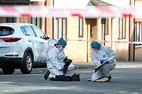 Pictured: Forensic scientists at the scene on High Street in Swansea, Wales, UK. Thursday 18 July 2019<br /> Re: Two people have been arrested following a serious assault which left a man in hospital.<br /> South Wales Police said it was called to High Street, Swansea, near to the disused Palace Theatre, at about 15:10 BST.