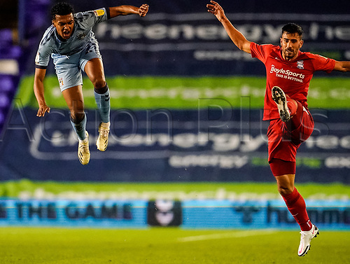 20th November 2020; St Andrews Stadium, Coventry, West Midlands, England; English Football League Championship Football, Coventry City versus Birmingham City; Jordon Thompson of Coventry City high in the air after colliding with Maxime Colin of Birmingham City