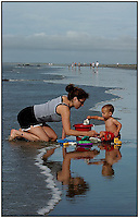 A mother and son interact during a family vacation to the beach near Charleston, SC.  Model released image may be used to illustrate other destinations or concepts.