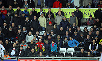 ATTENTION SPORTS PICTURE DESK<br /> Pictured: Swansea City fans in action <br /> Re: Coca Cola Championship, Swansea City Football Club v Leicester City at the Liberty Stadium, Swansea, south Wales. Saturday 16 January 2010