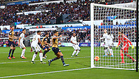 Olivier Giroud of Arsenal scores a goal to make the score 0-1 during the Barclays Premier League match between Swansea City and Arsenal played at The Liberty Stadium, Swansea on October 31st 2015