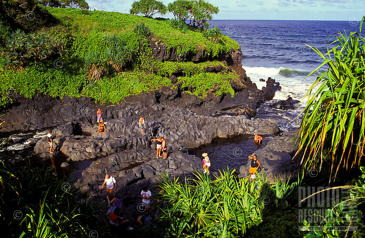 Tourists enjoy the lush scenery at the seven sacred pools in Oheo Gulch near Hana.