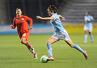 # 8 Megan Rapinoe of the Chicago Red Stars pushes the ball upfield against #10 Homare Sawa of the Washington Freedom. The Red Stars won the game 2-1