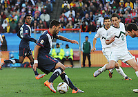 Midfielder Clint Dempsey cuts the ball back against the closing Slovenian defense. The United States came from a 2-0 halftime deficit to Slovenia to earn a 2-2 draw their second match of play in Group C of the 2010 FIFA World Cup.