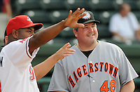 Greenville Drive manager Billy McMillon, left and Hagerstown Suns manager Matt LeCroy discuss the ground rules prior to a game on July 8, 2010, at Fluor Field at the West End in Greenville, S.C. McMillon and LeCroy, former Major Leaguers, both played ball at nearby Clemson University. Photo by: Tom Priddy/Four Seam Images