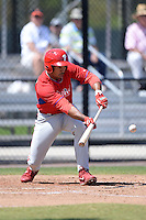 Philadelphia Phillies outfielder Samuel Hiciano lays down a bunt during a minor league spring training game against the Pittsburgh Pirates on March 18, 2014 at the Carpenter Complex in Clearwater, Florida.  (Mike Janes/Four Seam Images)