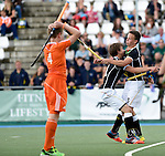 GER - Mannheim, Germany, May 25: During the U16 Boys match between The Netherlands (orange) and Germany (black) during the international witsun tournament on May 25, 2015 at Mannheimer HC in Mannheim, Germany. Final score 3-4 (1-2). (Photo by Dirk Markgraf / www.265-images.com) *** Local caption *** Ties Klinkhamer #4 of The Netherlands, Nicolas Kuehne #11 of Germany, Max Weiher #5 of Germany