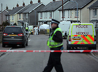 Police and forensics officers at the scene of a stabbing at the Ely area of Cardiff, south Wales, UK. 03 March 2016