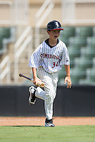 McKay Rowand, son of Chicago White Sox minor league outfield and base running instructor Aaron Rowand, performs his duties as bat boy during the South Atlantic League game between the Greensboro Grasshoppers and the Kannapolis Intimidators at Intimidators Stadium on July 17, 2016 in Greensboro, North Carolina.  The Intimidators defeated the Grasshoppers 3-2 in game one of a double-header.  (Brian Westerholt/Four Seam Images)