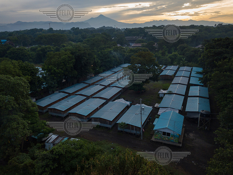Aerial view of one section of the Single-Family Transitional Shelters (ATUs in Spanish) where families from La Trinidad have been living since late 2018. The active Pacaya Volcano can be seen in the background.