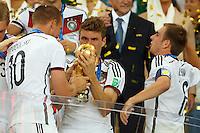 Thomas Muller of Germany celebrates winning the FIFA World Cup trophy pulling a funny face