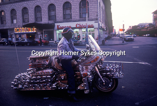 Coney Island New Jersey USA 1970s.  Man and his motor bike.