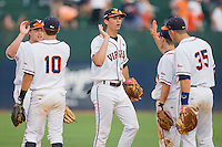 Jarrett Parker #3 (center) celebrates with his Virginia Cavaliers teammates at the Charlottesville Regional of the 2010 College World Series at Davenport Field on June 4, 2010, in Charlottesville, Virginia.  The Cavaliers defeated the VCU Rams 14-5.  Photo by Brian Westerholt / Four Seam Images