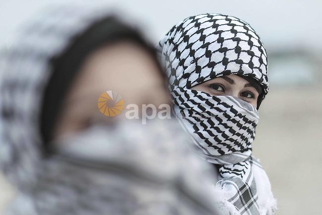 girls wearing Palestinian traditional checkered keffiyeh. Photo by Sanad Ltefa