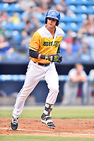 Beer City Tourists catcher Robbie Perkins (11) walks to first base during a game against the Lakewood BlueClaws at McCormick Field on June 1, 2017 in Asheville, North Carolina. The Tourists defeated the BlueClaws 8-5. (Tony Farlow/Four Seam Images)