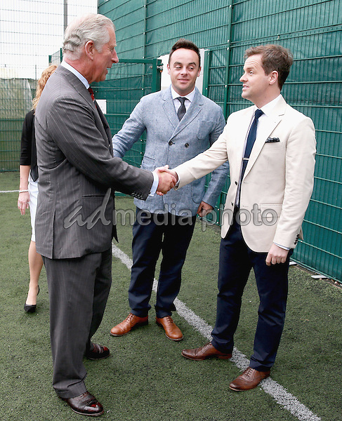 06 July 2015 - Bridgend, Wales - Prince Charles, Prince of Wales meets young offenders taking part in a Get Started with Football programme run by the Prince's Trust during a visit to Parc Prison in Bridgend, Wales. Photo Credit: Alpha Press/AdMedia