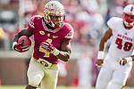 Florida State running back Dalvin Cook gets outside NC State tight end Cole Cook as Florida State defeated N.C. State 34-17 during their NCAA homecoming game in Tallahassee, FL November 14, 2015.