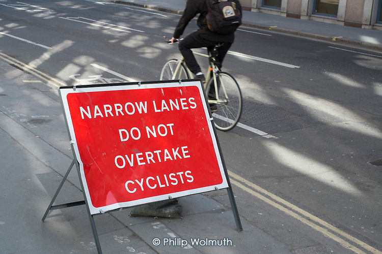 Temporary warning sign on a road in central London.  14 cyclists were killed in road accidents in London in 2014.