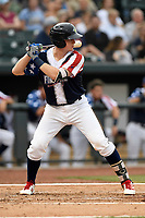 Catcher Dan Rizzie (5) of the Columbia Fireflies bats in a game against the Rome Braves on Monday, July 3, 2017, at Spirit Communications Park in Columbia, South Carolina. Columbia won, 1-0. (Tom Priddy/Four Seam Images)