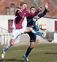 Arbroath's Euan Smith and Albion's Gary Philips challenge for the ball.