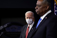 President Joe Biden listens as Secretary of Defense Lloyd Austin speaks at the Pentagon, in Arlington, Virginia, 10 February 2021.<br /> CAP/MPI/RS<br /> ©RS/MPI/Capital Pictures