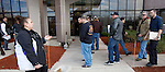 MIDDLETOWN CT. 30 December 2013-123013SV04-At left, Samantha Savino of Special Licensing and Firearms help owners of assault weapons and high capacity magazines with their paper work as they wait in line to register them at the Department of Emergency Services and Public Protection Special Licensing and Firearms in Middletown Monday. <br /> Steven Valenti Republican-American