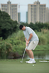 Yao Ming putts during the World Celebrity Pro-Am 2016 Mission Hills China Golf Tournament on 21 October 2016, in Haikou, China. Photo by Weixiang Lim / Power Sport Images
