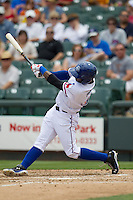 Round Rock Express shortstop Jurickson Profar #10 swings the bat against the New Orleans Zephyrs in the Pacific Coast League baseball game on April 21, 2013 at the Dell Diamond in Round Rock, Texas. Round Rock defeated New Orleans 7-1. (Andrew Woolley/Four Seam Images).
