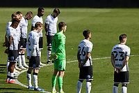 Swansea players observe a minute's silence in tribute to Prince Philip prior to the Sky Bet Championship match Swansea City and Wycombe Wanderers at Liberty Stadium, Swansea, Wales, UK. Saturday 17 April 2021