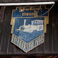 Myanmar, Burma.  Kalaw Train Station Emblem.