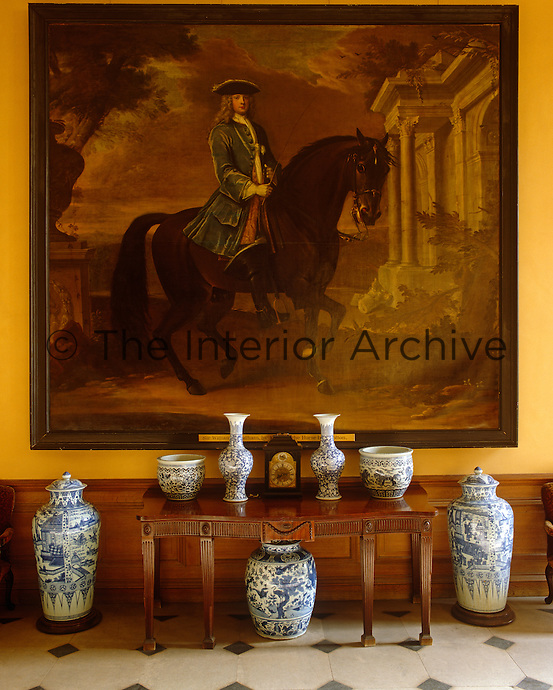 One of a series of portraits that decorate the walls of the entrance hall at Petworth House