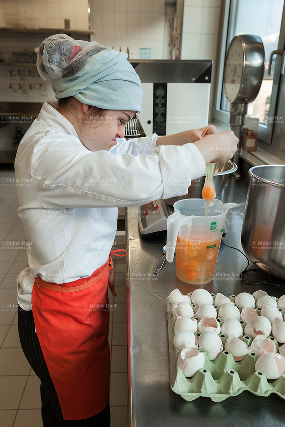 Switzerland. Canton Ticino. Sorengo. OTAF (Opera Ticinese per l'assistenza alla fanciullezza). OTAF protected laboratories offer adults with moderate working skills or disabilities an opportunity to carry out production activities in a protected environment. Elisabetta Montobbio is working in the pastry workshop. She breaks eggs which she will use in the making of poppy pies. Elisabetta Montobbio is a dancing member of MOPS_DanceSyndrome which is an independent Swiss artistic, cultural and social organisation operating in the field of contemporary dance and disability. It is composed only of Down dancers. Down syndrome (DS or DNS), also known as trisomy 21, is a genetic disorder caused by the presence of all or part of a third copy of chromosome 21 It is usually associated with physical growth delays, mild to moderate intellectual disability, and characteristic facial features. 27.01.2020 © 2020 Didier Ruef