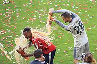 12.05.2018; Football,  2017/2018, Bundesligal, FC Bayern Muenchen - VfB Stuttgart, in Muenchner Allianz-Arena. German Meister FC Bayern Muenchen celebrates .  Sven Ulreich ueberschuettet Jerome Boateng and Weissbier *** Local Caption *** © pixathlon<br /> <br /> +++ NED + SUI out !!! +++<br /> Contact: +49-40-22 63 02 60 , info@pixathlon.de