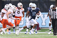 CHAPEL HILL, NC - OCTOBER 10: Dazz Newsome #5 of North Carolina is chased by Tyler Matheny #30 of Virginia Tech during a game between Virginia Tech and North Carolina at Kenan Memorial Stadium on October 10, 2020 in Chapel Hill, North Carolina.